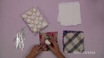 Inizia l'esperimento avvolgendo uova nella seta, il risultato che ottiene è stupendo