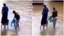 Durante l'alluvione il marito protegge così la moglie