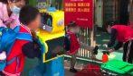 Coronavirus, così i bambini entrano a scuola in Cina