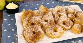 Easy apple, pear and banana fritters served with cream and cinnamon!