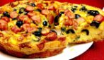 Savory cake with eggs and black olives: a recipe to try
