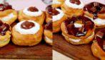 Ciambelle di pasta choux al cioccolato: per uno spuntino da leccarsi i baffi!